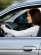 Woman driving with Car Hire Excess cover